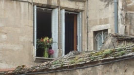 Flowers in open window, Beaune, France